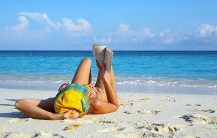 Women is reading on a beach